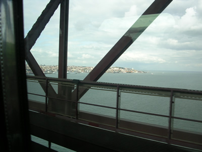 Public transport Alfa Pendular train view 25 April Bridge Lisbon downtowm