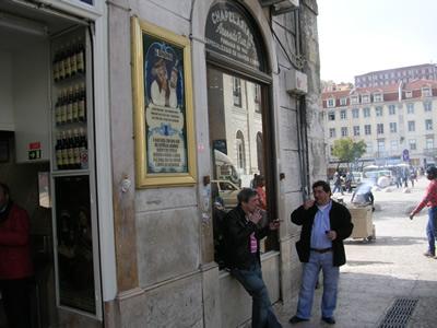 Lisbon Rossio Portugese man drinking a Ginja