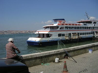 Lisbon Cacilhas Ferry and fisherman