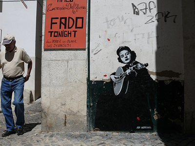 Stencilled paste-up of Amalia Rodrigues, Beco dos Cortumes August 2007