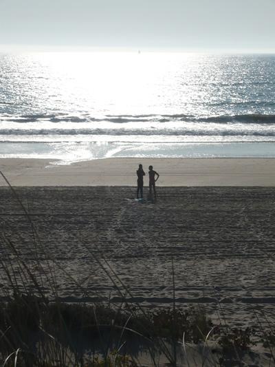Lisbon Costa da Caparica Beach 19 2 men near the sea