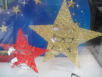 Lisbon remarkable Christmas window dressing stars wearing glasses