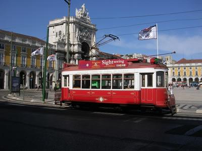Lisbon red tourist tram 7 hills Praca do Comercio