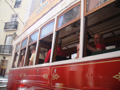 Lisbon historical red tram tour tourists