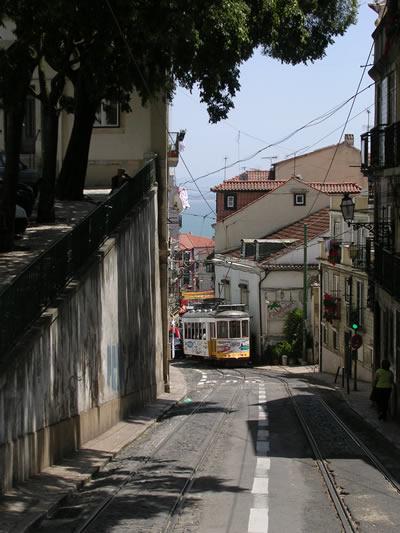 Lisbon historical red tram tour Alfama near flea market Feira da Ladra