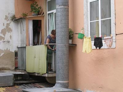 Bairro Alto hanging hand washing laundry