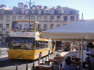 Lisbon sightseeing the yellow double decker Praca da Figueira