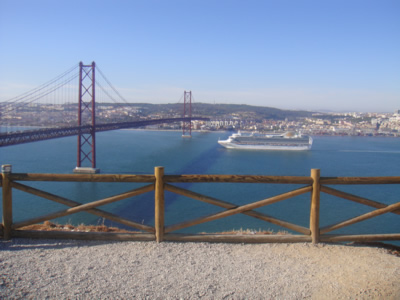 Lisbon view from Cristo Rei statue how to get there by cheap ferry