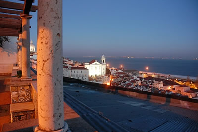 Lisbon Miradouro Santa Luzia by night view roofs Alfama and river Tejo
