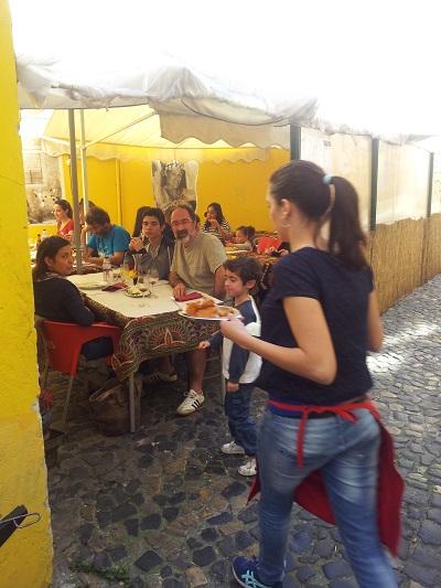 Cantinho do Aziz restaurant Mouraria Lisbon terrace March 15 2