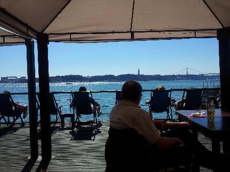 Lisbon terrace restaurant Cariocas de Rio near Tagus river 3 sunbeds